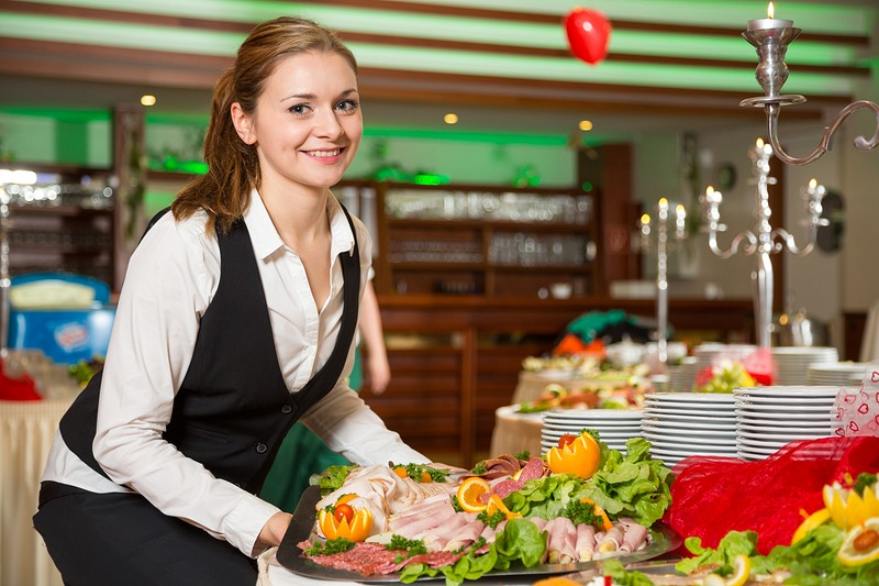 photodune-8018758-catering-service-employee-preparing-a-buffet-xxl